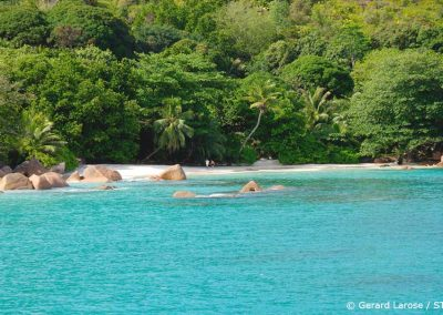 Curieuse Island Seychelles, A couple walking on the beach, Sailing Holidays